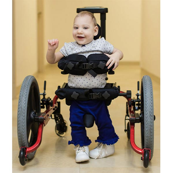 male toddler walking independently in the Prime Engineering KidWalk Pediatric Gait Trainer