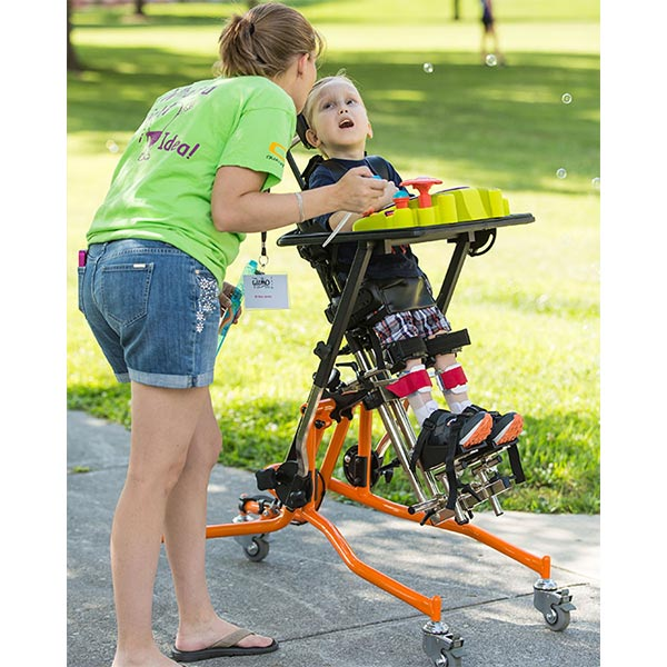 female caregiver with male child using the Prime Engineering Superstand HLT Pediatric Standing Frame