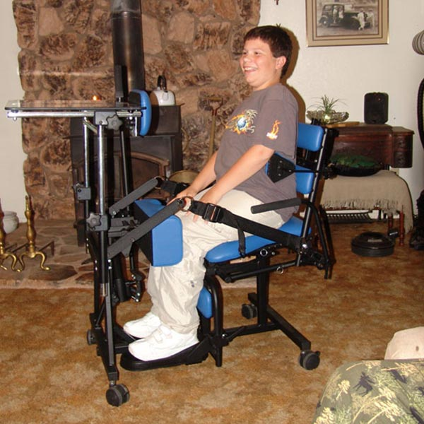 Teenage boy using the Prime Engineering Symmetry Youth Pediatric Standing Frame